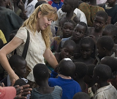 Carol Ward with a group of children
