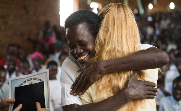 Hugging Carole Ward After Receiving Bible