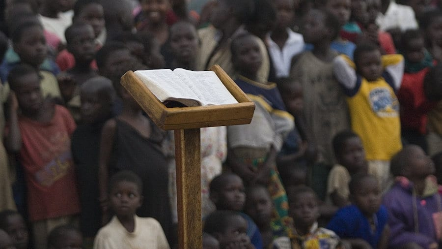 Bible on stand infront of crowd