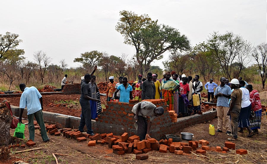 Villagers Buidling New Church